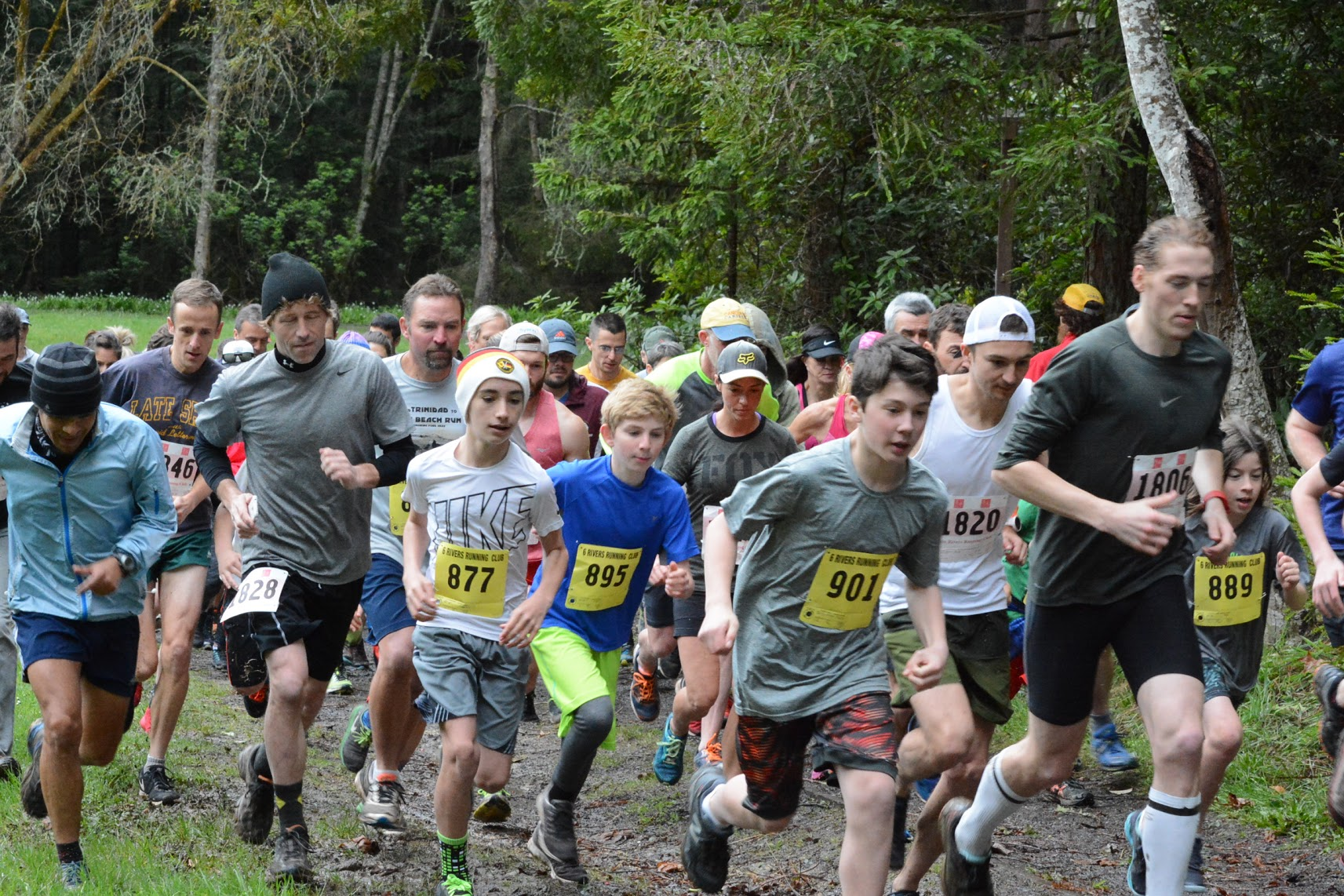 Locals, families, and kids take off at the start of the two mile race in Redwood Park.   Erin Chessin