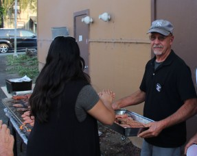 Community members helping the family by preparing and serving the food. | Photo by Sarahi Apaez