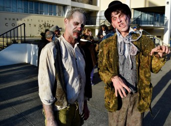 Daniel Baer (left) and Anthony Mankins (right) loosen up their belts as they get ready to have the feast of the year in the annual Zombie Walk on Oct. 7.