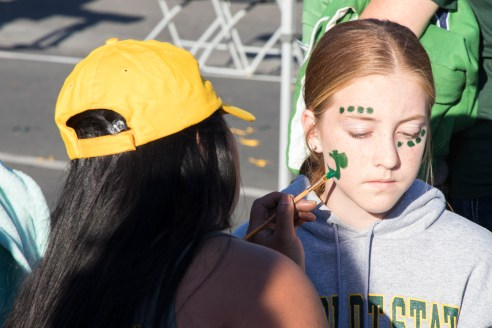 Kristina Tobin, 12, gets her face painted in the SBS Parking Lot during the HSU homecoming tailgate on Oct. 14, 2017.