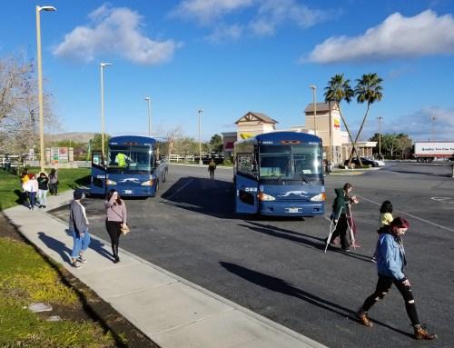 Students return to campus by Homeward Bound bus