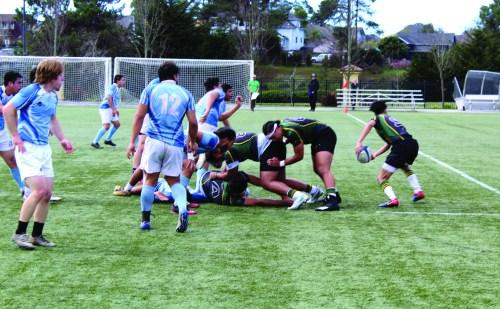 HSU men's rugby team forms a ruck