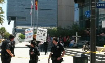 A small crowd of anti-science advocates sits in front of the LA Police Department Headquarters   Photo by Kelly Bessem