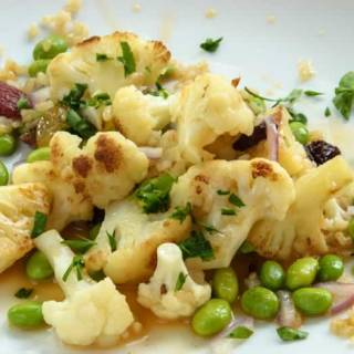Warm Cauliflower Salad with Edamame & Raisins