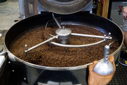 The coffee beans are kept in motion while cooled to maintain control of the integral process. Photo by Griffin Dehne.