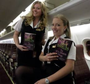 Flight Attendants with some sexy inflight reading, The Sex Demon Trilogy by Jaye Shields