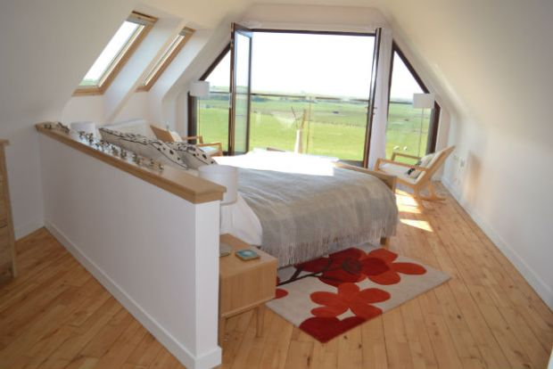 bedroom at Dundream with sea view