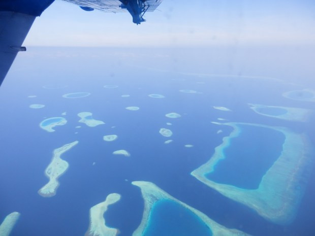 AERIAL VIEWS OF ATOLLS DURING WATERPLANE TRANSFER