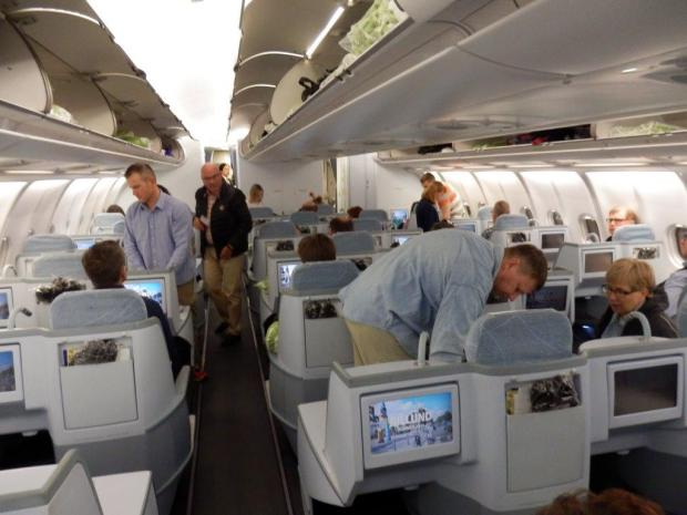 BUSINESS CLASS CABIN DURING BOARDING PROCESS
