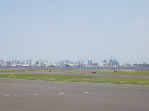 FLIGHT PATH: TOKYO SKYLINE AS SEEN FROM RUNWAY