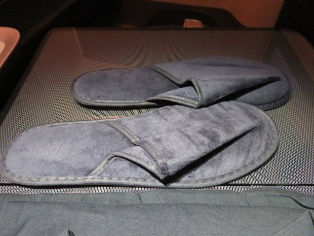 FIRST CLASS AMENITIES: SLIPPERS