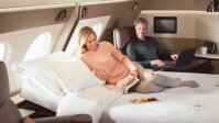 BOOK SQ FIRST CLASS WITH MILES
