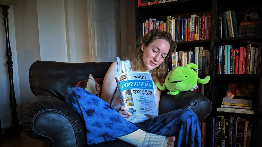Alexa reads a book about lymphedema to a plush lymph node toy.