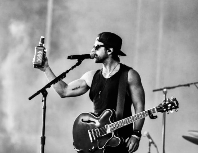 Kip Moore with a bottle of Jack Daniels