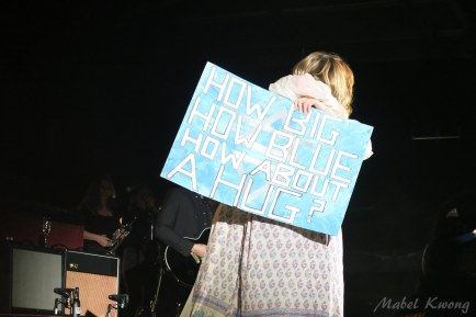 Hug. All because of a sign, a try.