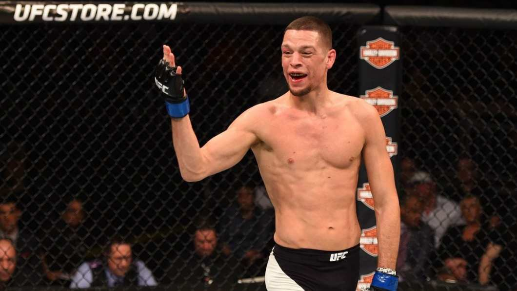 https://i0.wp.com/themaclife.com/wp-content/uploads/2017/01/121915-UFC-Fight-Night-Nate-Diaz-taunts-Michael-Johnson-PI.vresize.1200.675.high_.31.jpg?w=1060&ssl=1