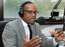 col_rahim-islam-talking-on-radio_org_0