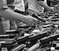people-sorting-large-lots-piles-guns-handguns