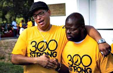 """Two men bond during Saturday's """"300 Strong"""" event, the first gathering of what is now the Black Male Collaborative. Photo courtesy of Universal Companies."""
