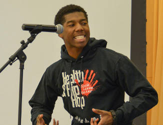 Grim Jackson, an 18 year-old, freshman communications major at Morgan State University performs during the spoken word competition during the Health and Hip-Hop Conference at Morgan State University. (Freddie Allen/BAI)