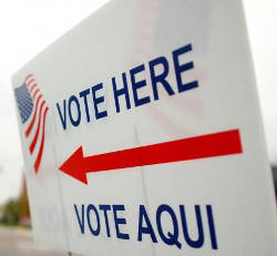 vote-here-vote-aqui-red-arrow-american-flag-sign