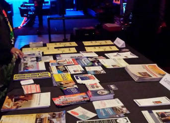 Voter education materials at the Onyx club in Milwaukee. Chuck Quirmbach/WPR.