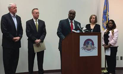 Mayor Tom Barrett, U.S Attorney for the Eastern District of WI Gregory Haanstad, Attorney Christine Donahue and Francesca Yerks listen as HUD Midwest Regional Administrator Antonio Riley speaks. Photo by Dylan DePrey