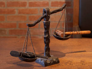 scales-of-justice-gun-outweighs-gavel