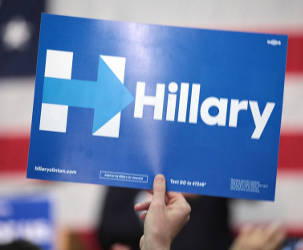 hand-holding-hillary-clinton-logo-sign-white-text-blue-background