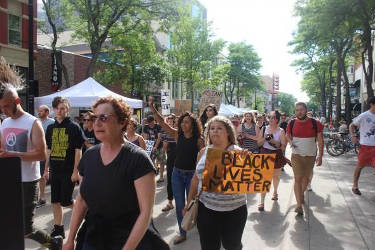 Several hundred people marched up State Street, around the Capitol to the Dane County Public Safety Building in support of Black Lives Matter. Bridgit Bowden/WPR