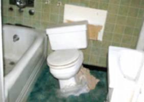 toilet-falling-through-floor-off-wall
