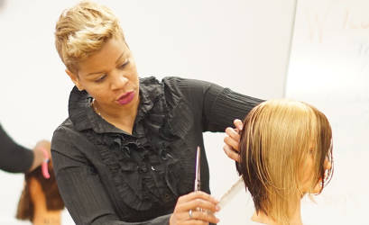 "Evalyn ""Evie"" Johnson has traveled the world to share the hair care techniques she's honed over 20 years as a stylist."