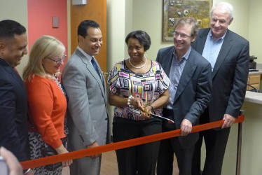 Lennie Mosley, of Halyard Park Neighborhood Association, cuts the ribbon opening the Thurgood Marshall Apartments Ross Terrell/WPR