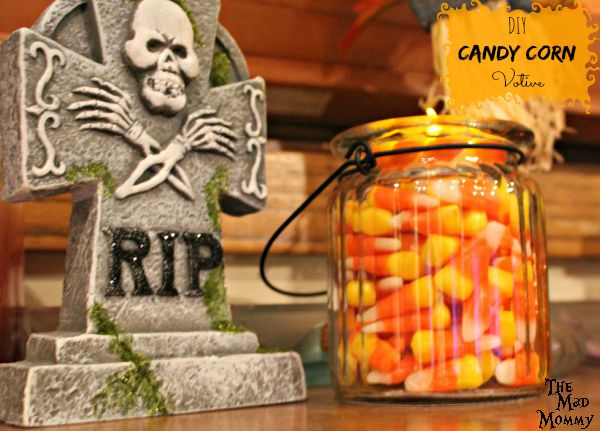 Add a little Halloween flair to your fall decor with this super simple DIY Candy Corn Votive!