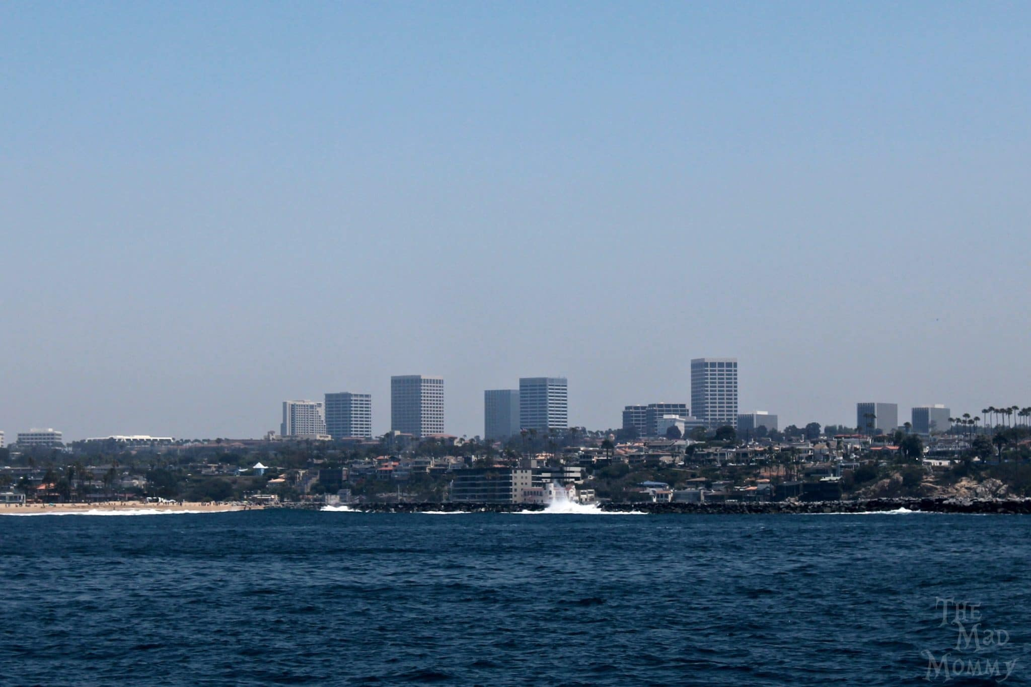 "Heading back into the marina from our whale watching tour. You can see a giant wave hit the ""Wedge""."