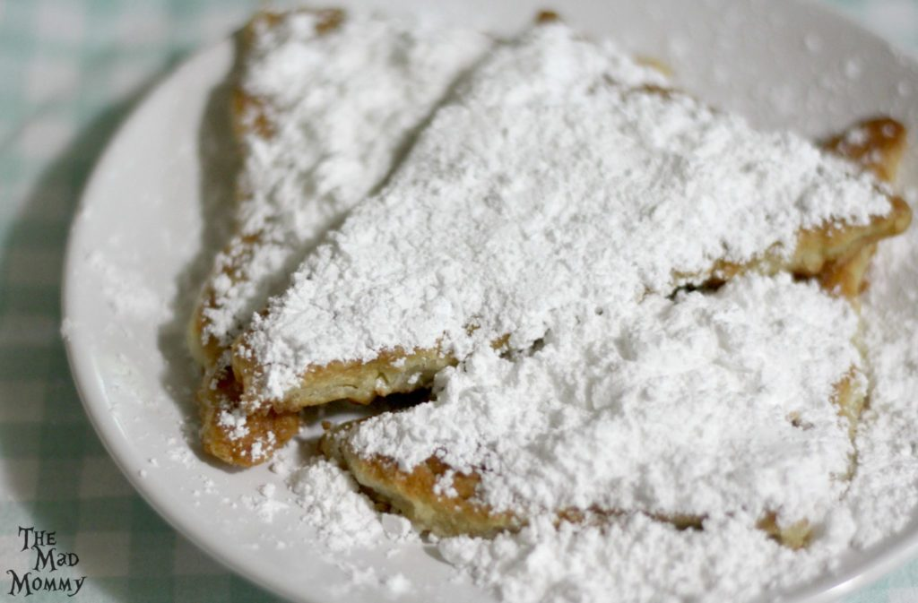Imagine yourself, deep in the French Quarter. The hustle and bustle of that NOLA traffic is music to your ears, as you sit in a cafe and sip on your freshly brewed latte. Suddenly, everything stops as your server sets a hot, sweet, just fried batch of beignets on your table.