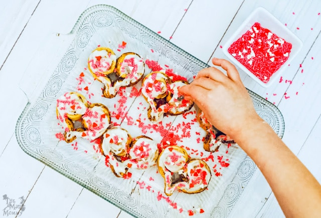 Sprinkling until your heart is content on these Sweetheart Cinnamon Rolls.