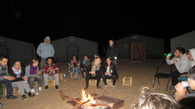 Sitting around the campfire in the evening