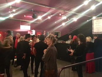 In the bar; most people adhered to the request for red and black outfits for the tea party