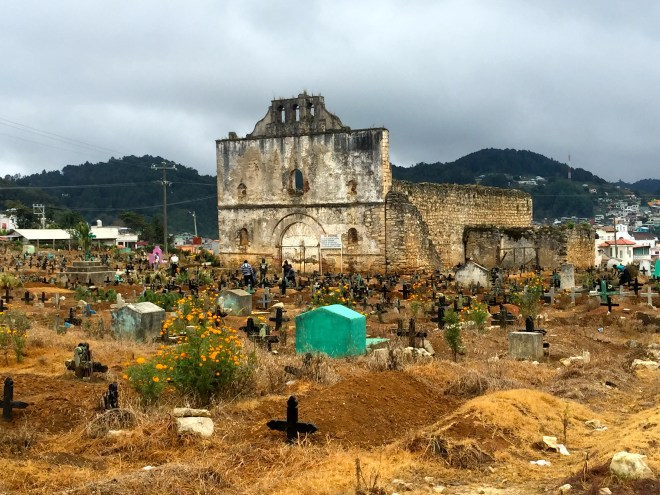 The ruins of the old church as you come into Chamula.  If you notice the different coloured crosses, black is for an old person, white for a baby and blue somewhere in between.  The people are sweeping the graves ready for Day of the Dead, when they will make offerings to their dead relatives.