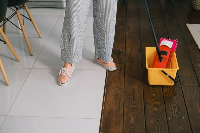 A woman mopping the floors.
