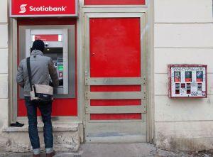 Man at bank machine apparently refinancing goddamn mortgage
