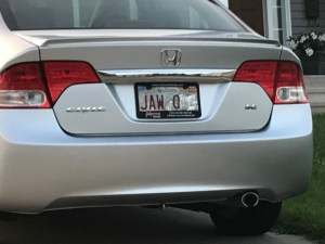 Local man uses peeling licence plates to distract wife during lockdown
