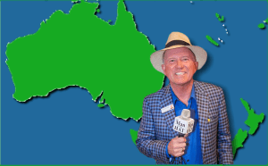 The Man In The Hat in front of map of Australia & New Zealand