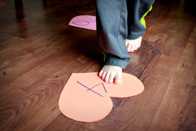 With just a few sheets of construction paper and some scissors, you can create five fun super simple Valentine's preschool games to help kids learn colors, numbers, and have all sorts of fun.