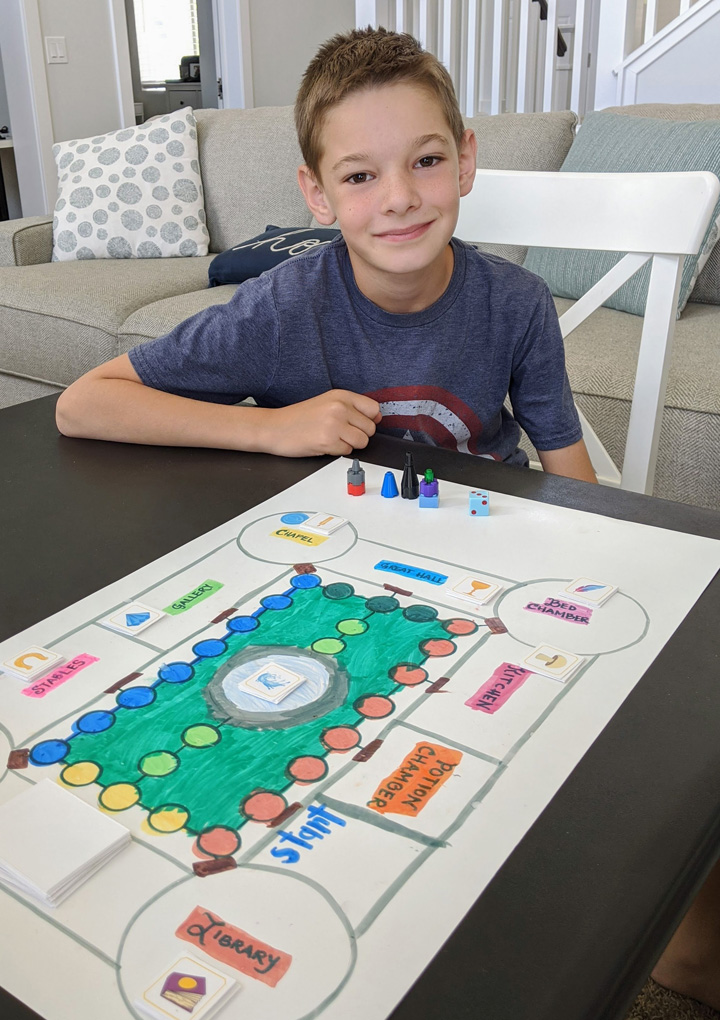 Boy with homemade board game