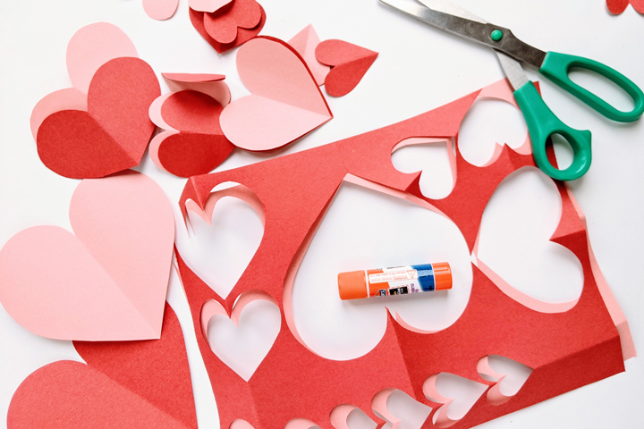 Valentine's Day craft supplies: paper, glue, scissors