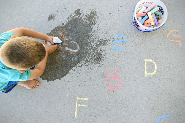 Grab a squirt bottle and some chalk and take learning outside with this fun outdoor alphabet game for preschoolers.
