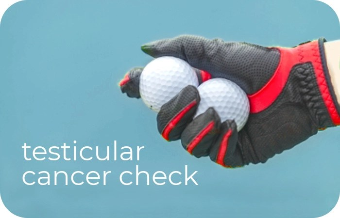 hand holding two golf balls