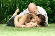 Couple on grass ©Juriah Mosin   dreamstime